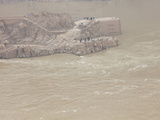 People on a Rocky Promontory in the Yellow River Just Below the Sanmanxie Hydroelectric Dam  China