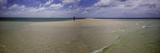 A Woman Walks on a Small Sand Island Sitting Atop Tubbataha Reef National Park