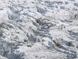A Mountaineer Climbing Among Crevasses on the Argentiere Glacier  Chamonix France