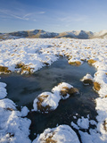 A Frozen Tarn on the Fells Above Kentmere in the Lake District  UK