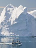 Fishing Boat Sails Through Icebergs