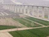 Building a New Raised Railway Bridge over Agricultural Fields in Shanxi Province in Northern China