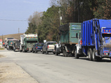 Row of Trucks Entering the Charleston County Landfill  Charleston  South Carolina  USA