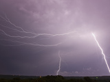 Multiple Cloud to Ground and Intracloud Lightning Flashes Behind a Storm Near Norman  Oklahoma