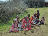 Group of Masai Women and Children Sitting on the Plains of the Serengeti  Tanzania  Africa