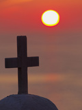 Cross on Church at Sunset over the Ocean  Mykonos  Greece