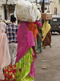 Colorful Indian Women in Traditional Saris Leaving Market in Udaipur with Containers on their Heads