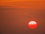 Sun in a Red Sky at Sunset  Serengeti National Park  Tanzania  Africa