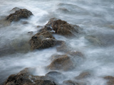 Blurred Motion of Waves Crashing over Rocks
