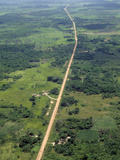 Aerial Image of a Road Through Former Rainforest Cleared for Agriculture and Cattle Raising