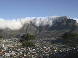 Towering over Cape Town  Table Mountain with its Famous Fog and Cloud Cover  South Africa