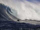 A Tow-In Surfer Drops Down the Face of Big Surf at Peahi (Jaws) Off Maui  Hawaii  USA