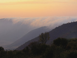 Morning Mist Rolling over Crater Rim into the Ngorongoro Crater  Tanzania  Africa
