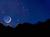 Crescent Moon with Earthshine Above a Cloud Layer with the Constellation Orion