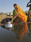 Women Gathering Water in Buckets from an Open Water Well  Pushkar Fair  India