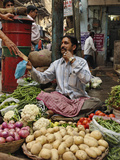 Man Selling Vegetables in an Open Air Market in Delhi  India