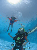 Junior Open Water Diver in Training with Young Girl Snorkeling in the Pool  Egypt