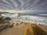 Altostratus Cloud Layer Above Waves Crashing onto and Eroding Sandstone Rocks and the Sandy Beach