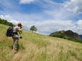 A Photographer in the Beautiful Scenario of the Apennines  Italy