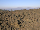 7000 Year-Old Aa Lava Flow from Lava Butte with Volcanic Peaks of the Cascade Mountains