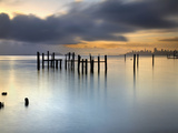 San Francisco and San Francisco Bay at Sunrise  with Old Pier Pilings under Cloudy Skies