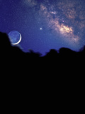 Crescent Moon with Earthshine Above a Cloud Layer with the Milky Way in the Background
