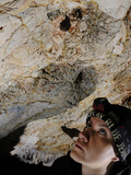 A Speleologist Observing a Bat in a Cave  Italy