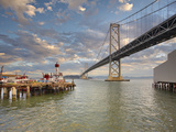 Bay Bridge and a Fire Boat Docked on its Pier  San Francisco Bay  California  USA