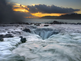 Waves Moving Over  Around  and into a Blowhole on the North Shore of Kauai at Sunrise