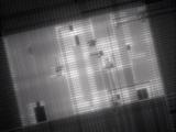 Micrograph of a Computer Microprocessor  LM X400  Epifluorecence  UV Illumination