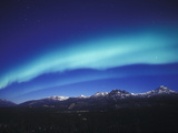 Aurora Borealis  Night Landscape Lit by a Full Moon  North America  Alaska  Alaska Range Mountains