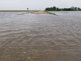 Agricultural Flooding from a Thunderstorm Covers a Rural Road in Western Nebraska