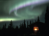 Aurora Borealis on a Cold Winter Night over a Cabin in the Taiga  Alaska  USA