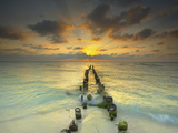 Sunset Behind an Old Eroded Pier Extending into the Ocean Near Cancun  Mexico