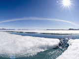 During the Arctic Spring  the Surface of the Frozen Arctic Ocean Begins to Crack under Stress