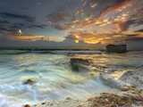 Coastline on Isla Mujeres  Mexico Showing Waves and Eroded Rocks under Cloudy Skies at Sunset