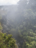 Volcanic Fog (Or &quot;Vog&quot;) Reduces Visibility and Partially Obscures a Ravine in Hawaii  USA