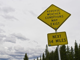 A Road Sign Warns of Adverse Weather Conditions Along the Continental Divide