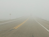 A Valley Fog Greatly Reduces Visibility and Creates Hazardous Driving Conditions