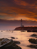 A Lighthouse and Wave Action at Sunset on the Rocky Shore Just South of Pigeon Point