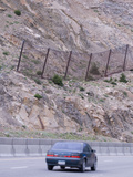 A Reinforced Metal Net Protects Motorists from Small Rockfalls Along an Interstate in Colorado