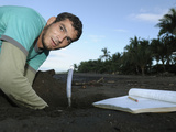 A Costa Rican Researcher Monitoring the Temperature in the Developing Olive Ridley Sea Turtle Nest