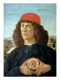 Portrait of a Young Man Holding a Medallion of Cosimo I De' Medici ('The Elder') (1389-1463)