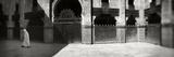 Muslim Man Walking in the Medersa  Medersa Bou Inania  Fez  Morocco
