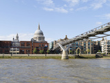 Bridge across a River with a Cathedral in the Background  London Millennium Footbridge  St Paul