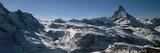 Skiers on Mountains in Winter  Matterhorn  Switzerland