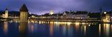 Buildings Lit Up at Dusk  Chapel Bridge  Reuss River  Lucerne  Switzerland