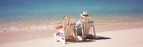 Couple Sitting in Adirondack Chairs on the Beach  Bahamas
