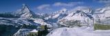 Group of People Skiing Near a Mountain  Matterhorn  Switzerland