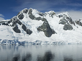 Reflection of a Snow Covered Mountain in Water  Antarctic Peninsula  Antarctica